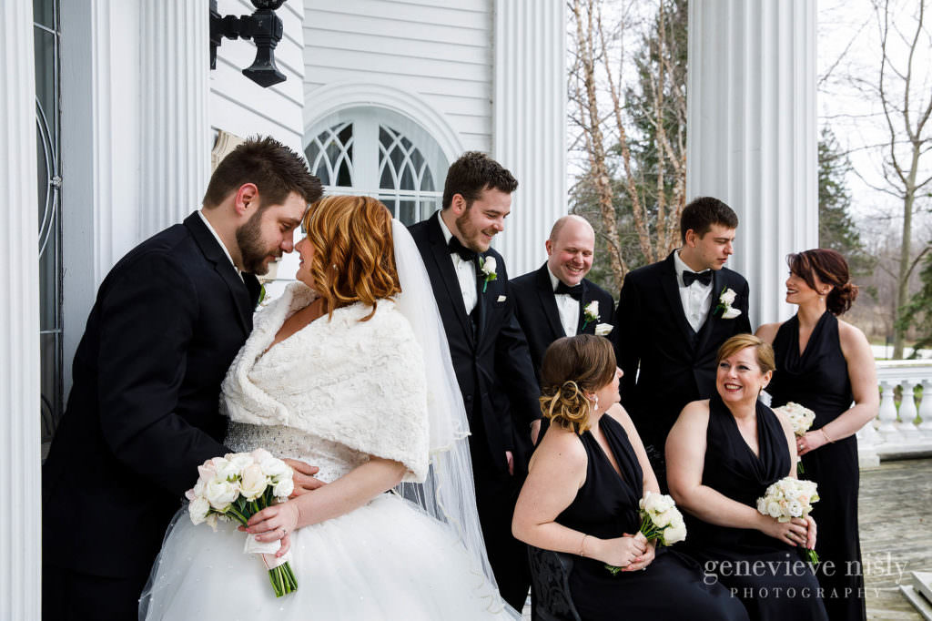 The bride, groom and their bridal party enjoying themselves outside the Mooreland Mansion in Kirkland.
