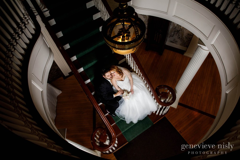 The bride and groom are looking striking sitting on the staircase inside Mooreland Mansion.