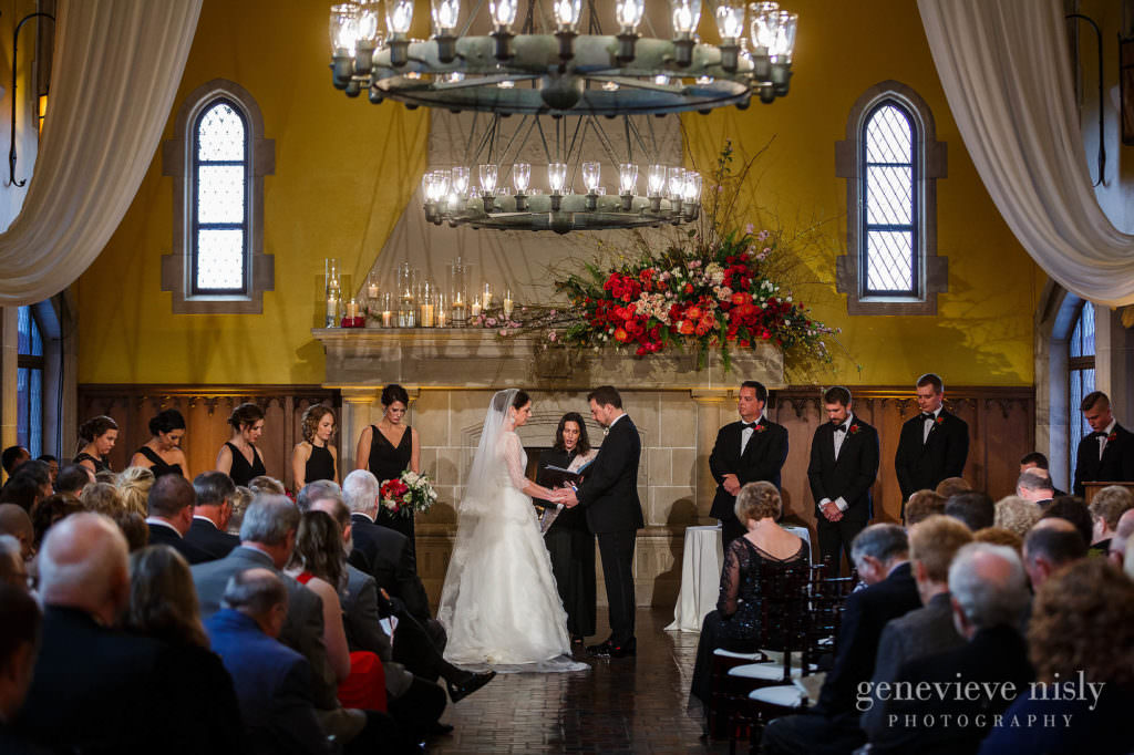 An overview of the wedding ceremony at Glenmoor Country Club with yellow walls.