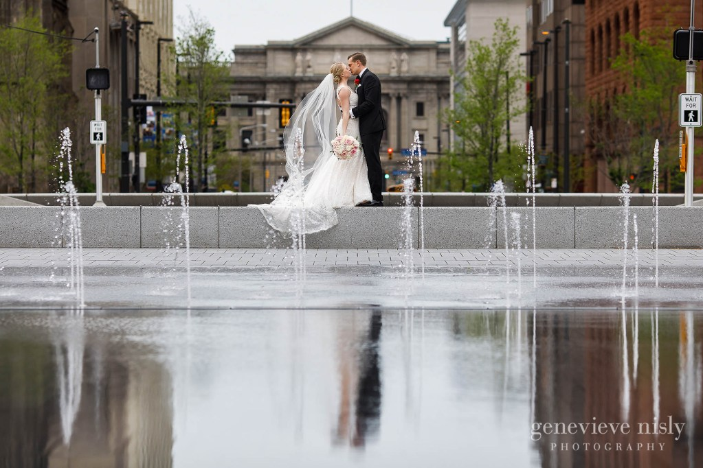 Brittany and Travis reflected in the splash pool in Downtown Cleveland's Public Square on their wedding day.