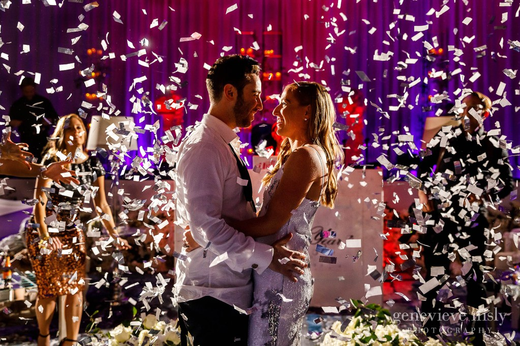 Kara and Jeremy celebrate with confetti during their New Year's Eve wedding reception at the Hilton Downtown in Cleveland, Ohio.