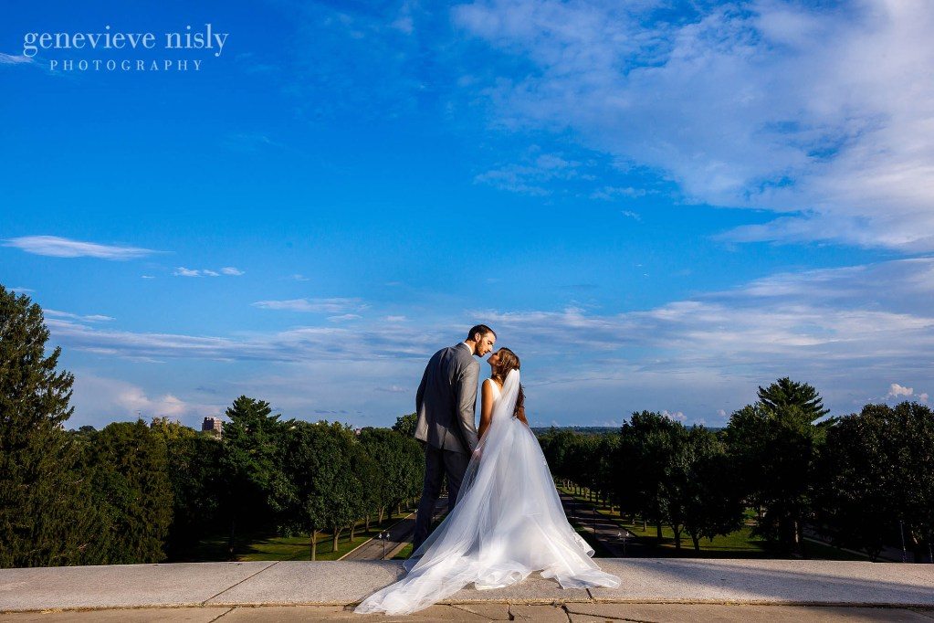Kosta and Eleni share a moment in front of a blue sky during their wedding in North Canton, Ohio.