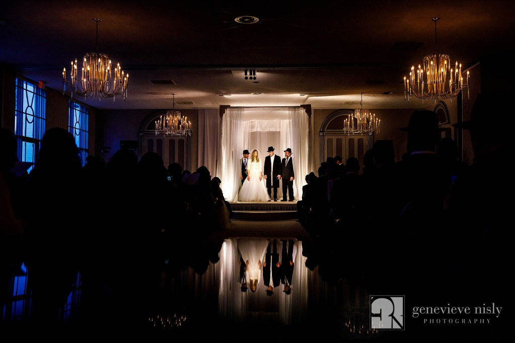 Nissan and Gila stand under the chuppah during their wedding ceremony in Cleveland, Ohio.