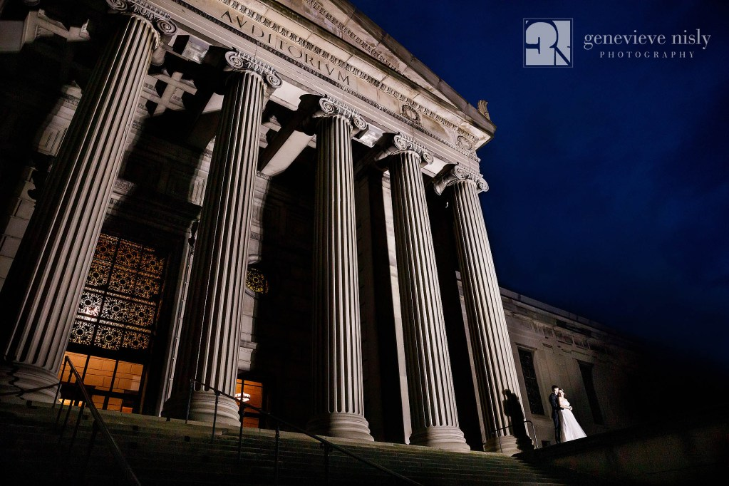 Matt and Brittany outside of Stambaugh Auditorium at night on their wedding day.