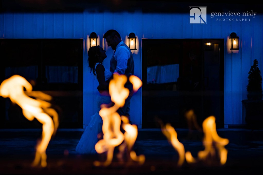 Richard and Amanda by the outdoor fireplace on their wedding day at the Rustic Ridge Wedding Barn in New Philadelphia, Ohio.