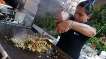 GRILL THRILLS' COOK MIXING THE INGREDIENTS FOR MONGOLIAN GRILL