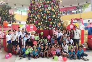 Kids are all smiles with their hosts at SM City General Santos after their exciting day in the mall.
