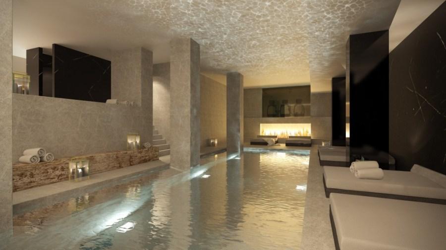 De ondergrondse spa heeft dubbele plafondhoogte, zwembad, hammam, sauna - en een open haard.