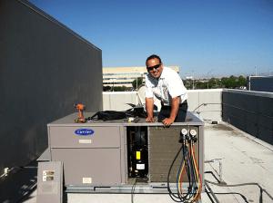 Gentec Service tech at HVAC Unit