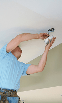 San Leandro Electrician installing smoke detector