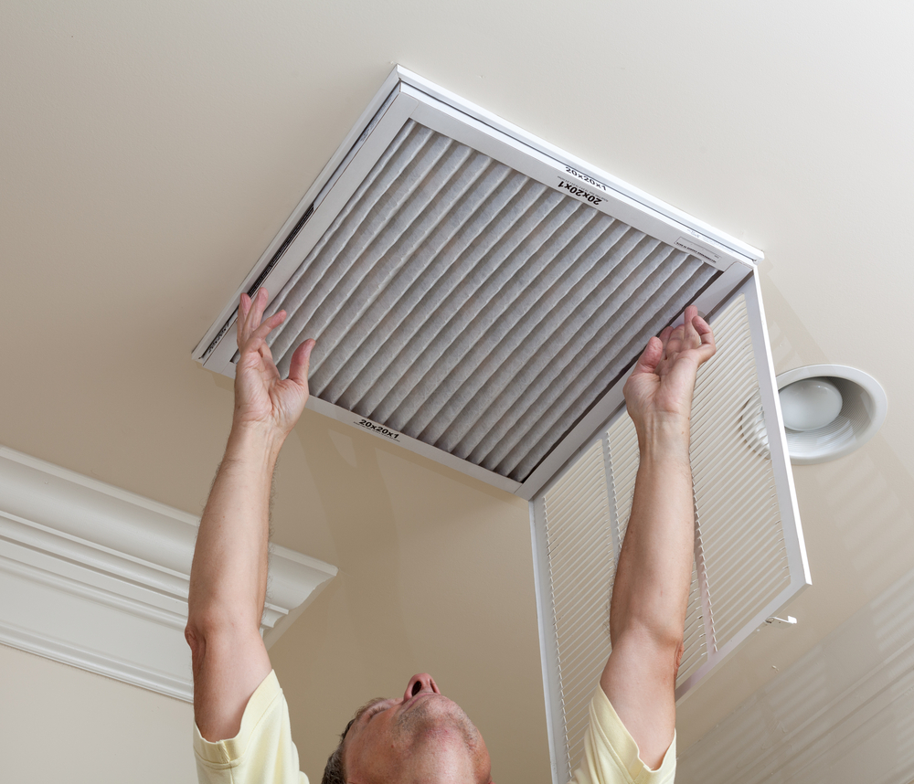 Removing a HVAC filter for cleaning