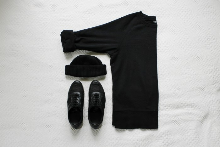 Black sneakers, a black hat and a black sweater.