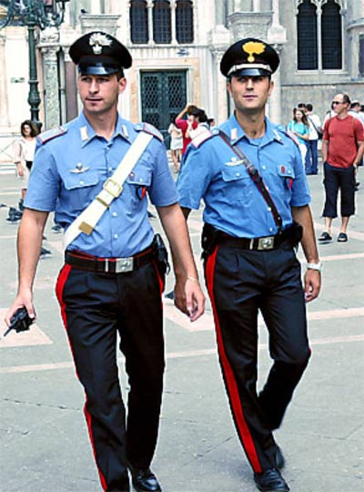 Italian policemen in flattering light blue uniforms