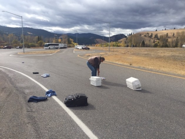 Scattered luggage on freeway ramp