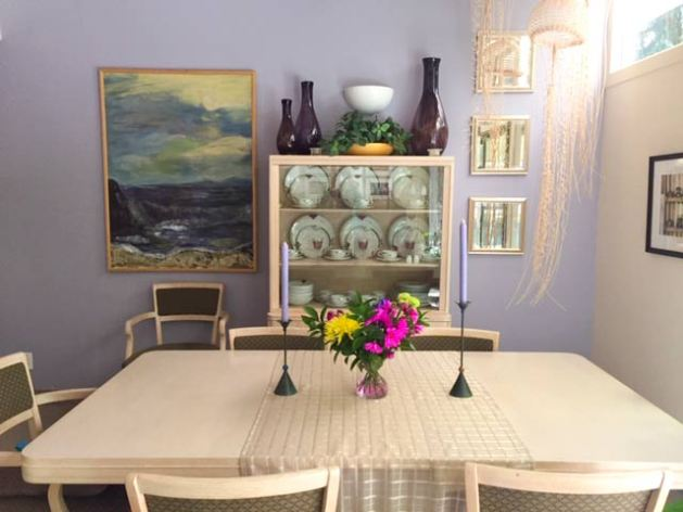 The periwinkle wall with Nancy's large seascape and aubergine blown-glass vases and three mirrors. I love them all!