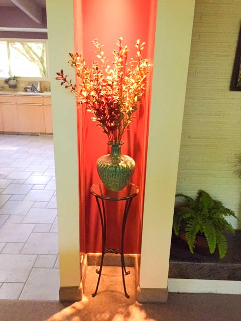 One of the three ugly vases - looks great on the wrought-iron stand in the alcove with red paint - who would have thought?