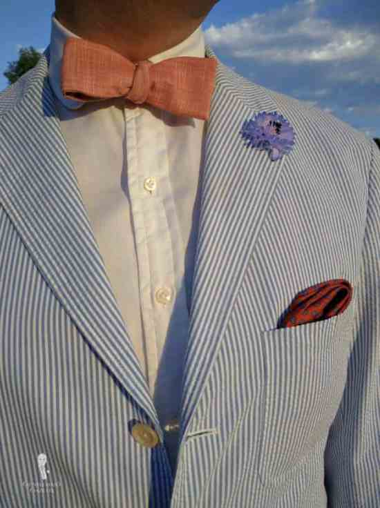 White Shirt with patch pocket seersucker suit, and orange and blue pocket square, bow tie and boutonniere by Fort Belvedere