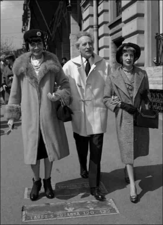 Jean Cocteau in short, white duffle coat with Coco Chanel & Miss Weiseveiller in Veneto Street, Rome 1958