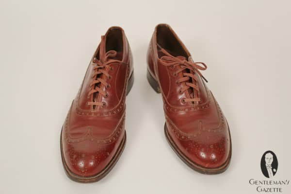 Reddish brown oxford wingtip brogue shoes - note the cross lacing