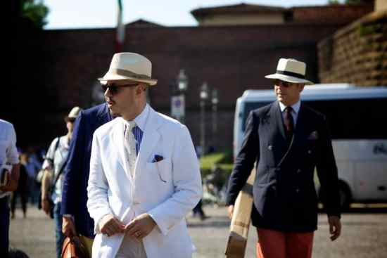 White blazer, of white knit tie, straw, short brim hat & sunglasses in pocket