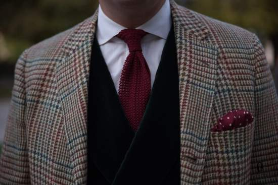 Burgundy Prince of Wales jacket with green overcheck; knit tie and pocket square from Fort Belvedere