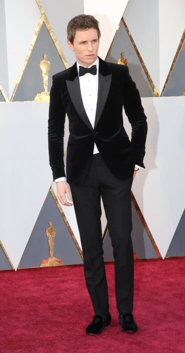 Eddie Remayne in black velvet dinner jacket with black velvet slippers but no cummerbund or vest