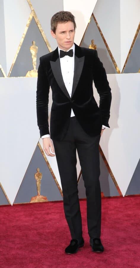 Eddie Remayne in black velvet dinner jacket with black velvet slippers but no cummerbund or vest