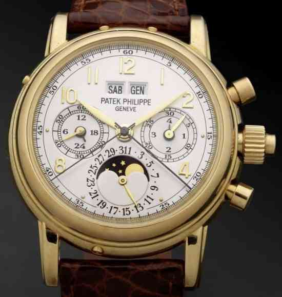 Patek Philippe. A very fine and rare 18ct gold manual wind perpetual calendar split seconds chronograph wristwatch with moon phases
