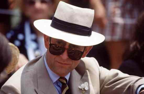 Prince Charles in RayBan Sunglasses with Panama hat and Gardenia Boutonniere