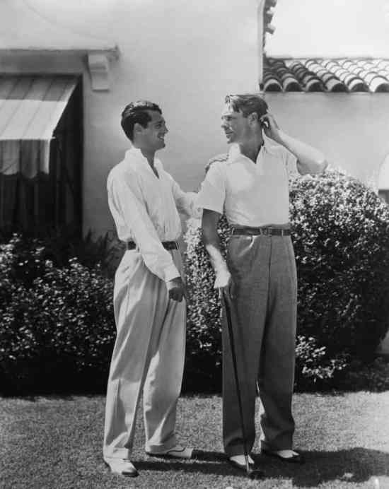 Cary Grant in The Red List wearing spectators and full cut trousers