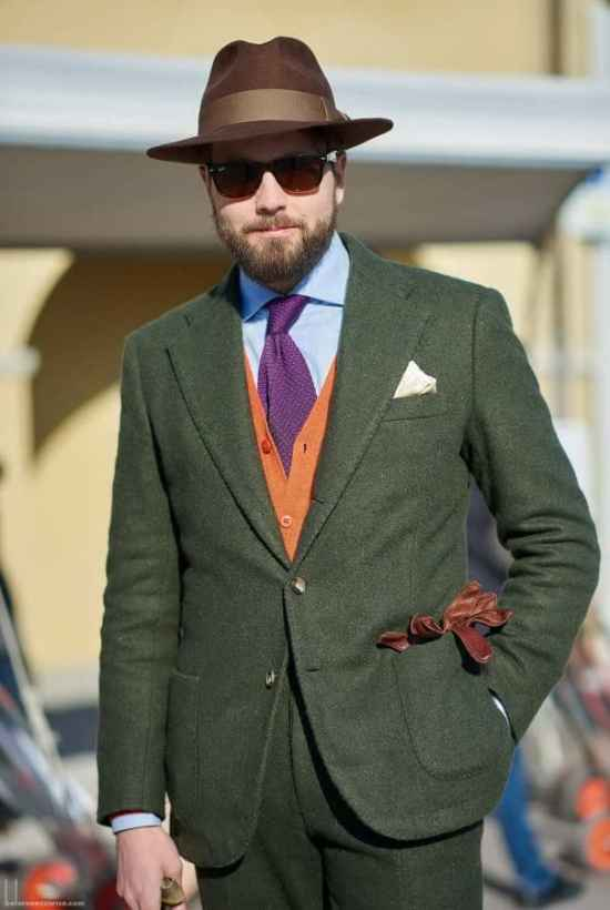 Beutiful green suit with orange knit vest and purple knit tie, brown hat and gloves as seen by beforeeesunrise.com