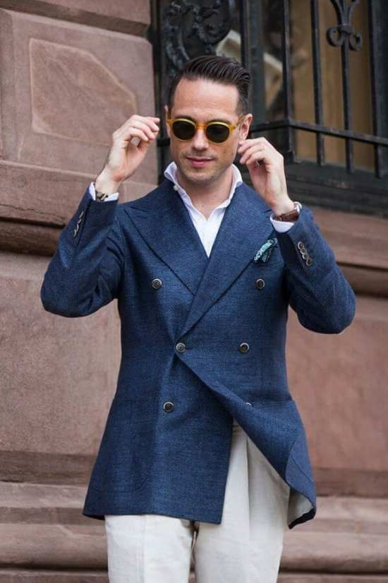 Brian Sacawa in a blue diagonal twill DB blazer with horn buttons and contrasting light colored trousers
