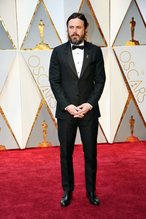 Casey Affleck in a Louis Vuitton 2 button peaked lapel tuxedo