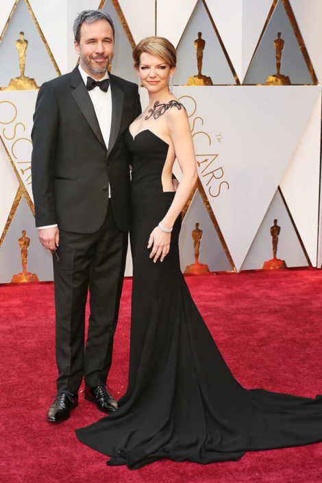Denis Villeneuve with notched lapel 2 button tuxedo and no cummerbund but nice bow tie and interesting oxfords