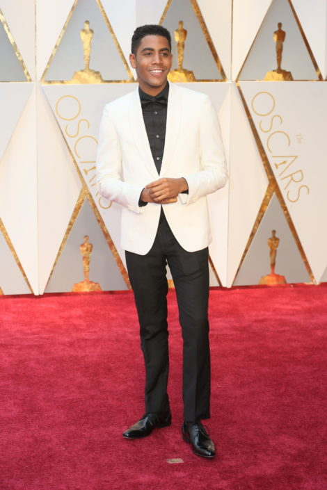 Jharrel Jerome in white dinner jacket withou pocket square and black shirt, with pre-tied bow tie