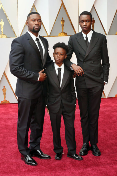 Trevante Rhodes, Alex R. Hibbert and Ashton Sanders in Calvin Klein tuxedos with flap pockets, and neckties paired with unusual shoes