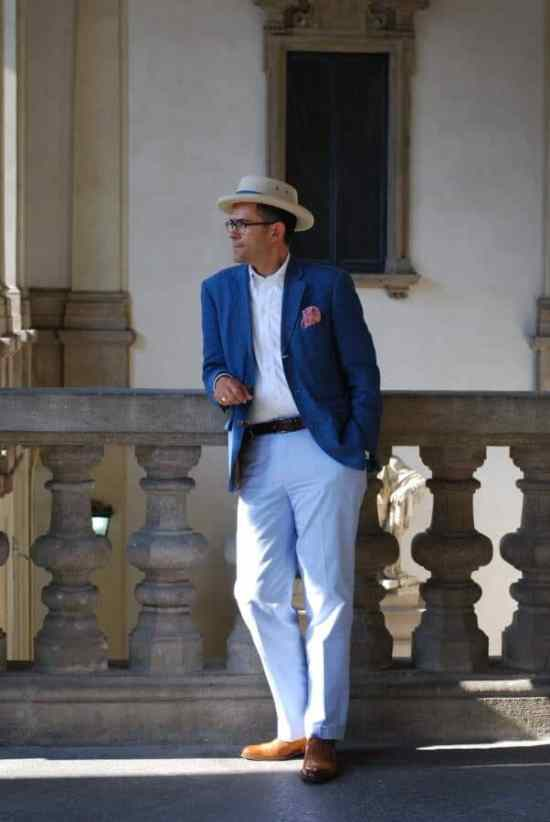 Pedro Mendes in summer blue jacket with pink flowery pocket square, white button down shirt, sky blue chinos and tan oxfords