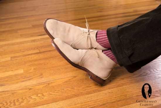Sand Chukka boots with green corduroys and burgundy and sand stripes socks