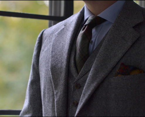 A gray flannel suit with matching waistcoat