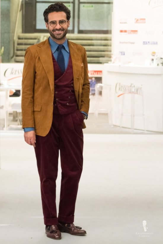 Leather sport coat with burgundy corduroy vest and trousers paired with denim shirt