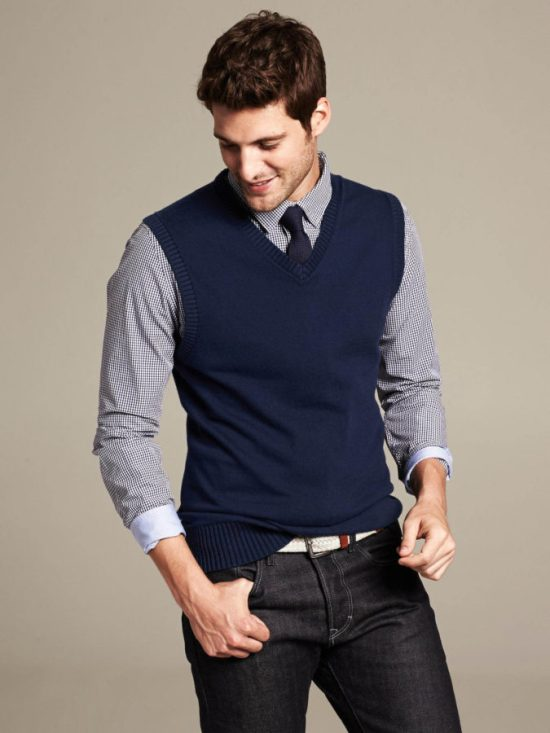 This sweater vest is perfect for layering or wearing under a blazer