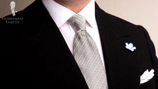 Dark suit with Light Blue Veronica Persica Boutonniere, Silver Black Silk Basketweave Tie, & White Pocket Square with Monogram