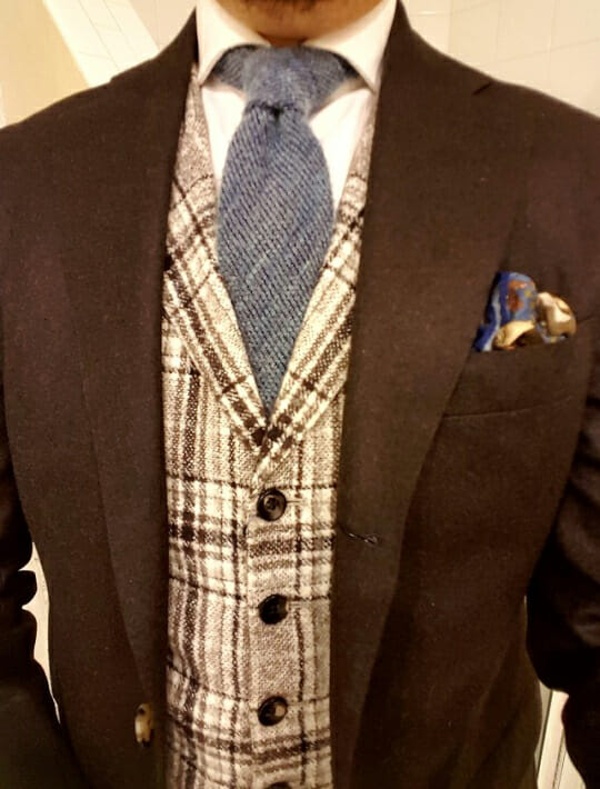 The author wearing a waistcoat with a brown plaid pattern to match a brown flannel suit.