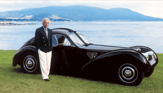 Ralph Lauren in a Navy Double Breasted Blazer and White Pants