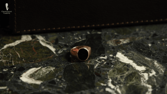 14 karat rose gold ring with an oval Onyx