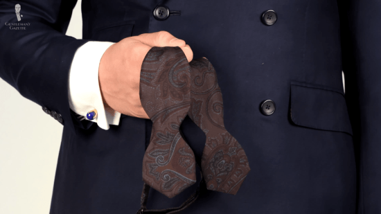 Brown and pale blue paisley bow tie