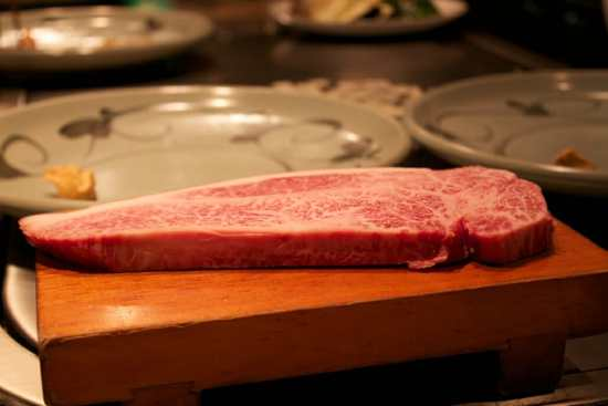 A cut of beef such as the one pictured here, with little connective tissue and finely marbled fat, will be more tender and flavorful.
