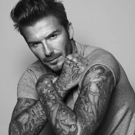 David Beckham with a full sleeve tattoo
