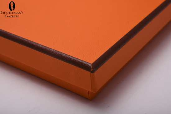 Orange Hermes tie box with brown edges