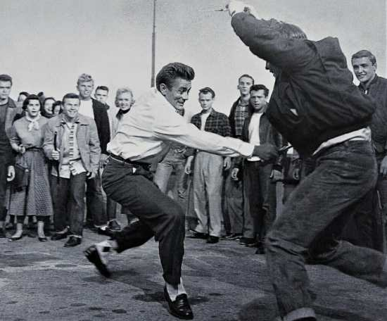 Jim Stark (Dean) and Buzz Gunderson (Corey Allen) in a knife fight in Rebel Without a Cause.